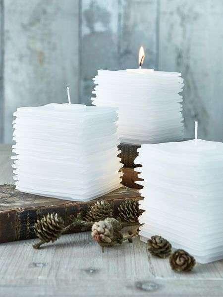 candele profumate per la casa con pigne