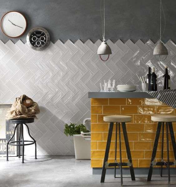 kitchen wall tiles are arranged in a herringbone pattern.