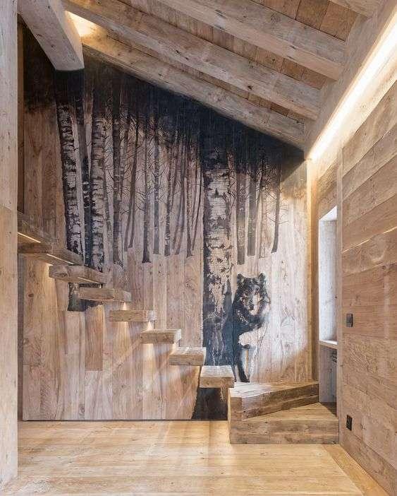 casa in montagna con scultura a parete